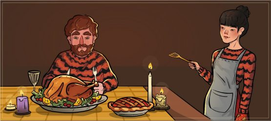 a girl and a gut in tiger sweaters are eating at the table