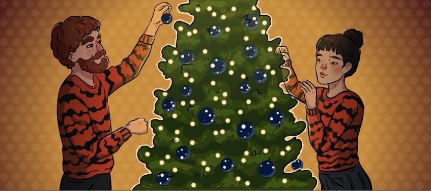 a girl and a boy in tiger sweaters are decorating christmas tree
