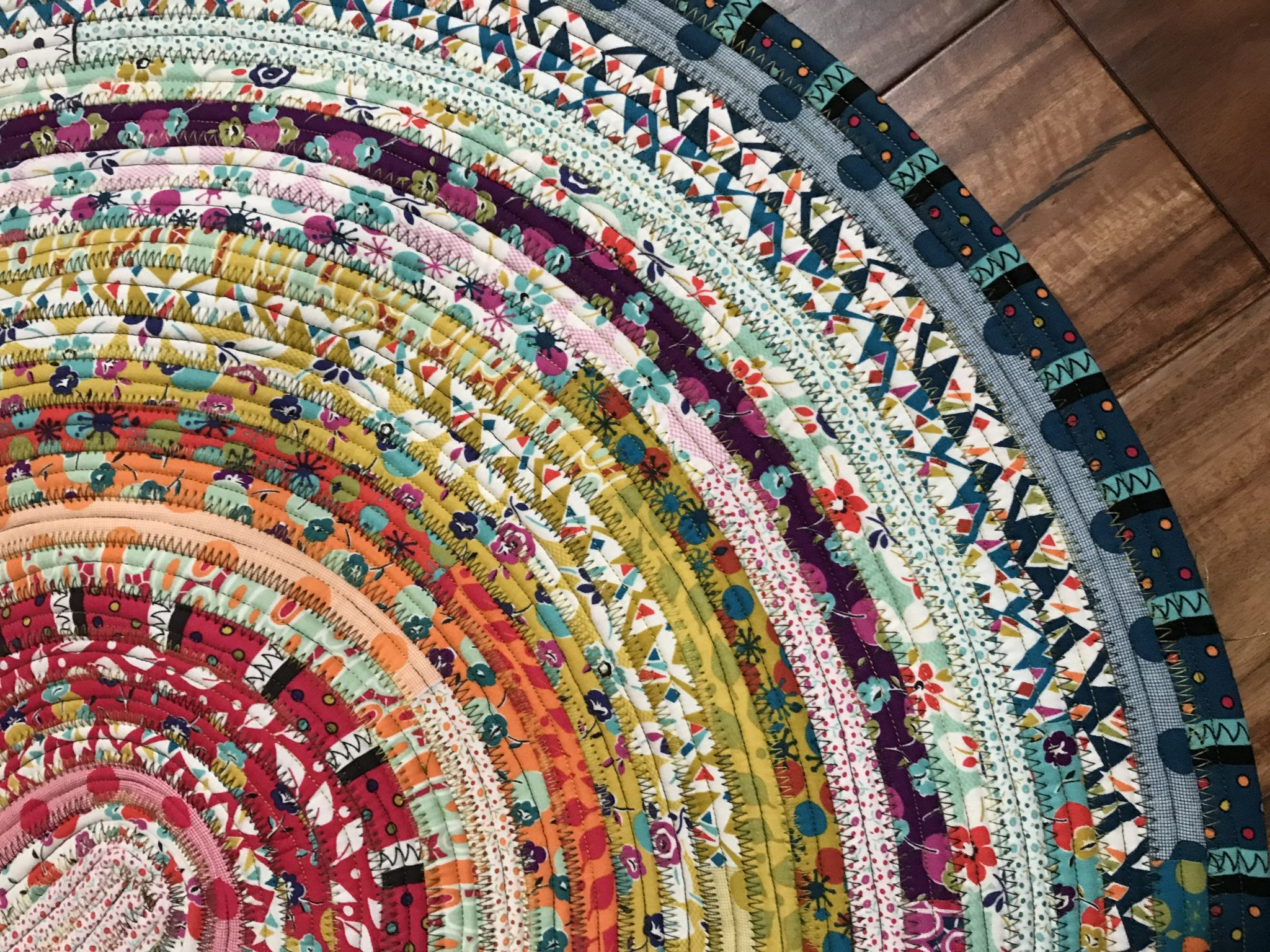a colorful rug made of stripes