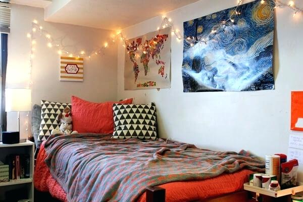 a cute college dorm room decorated with lights