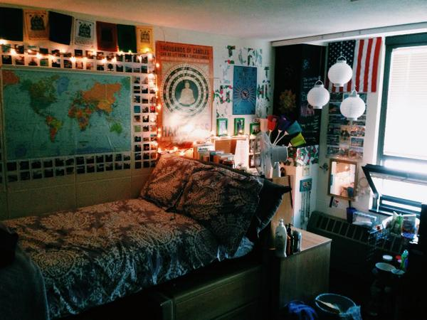 a dorm room decorated with wall posters