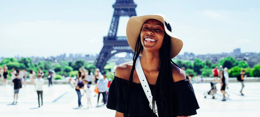 a girl laughing near the Effeil Tower