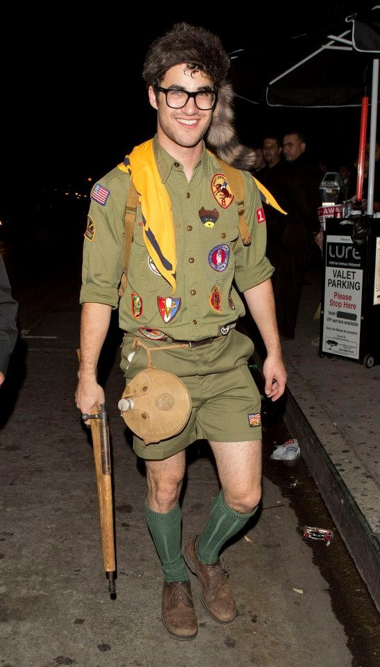 a guy wearing a boy scout costume