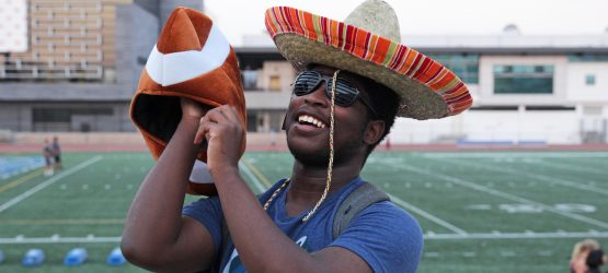 a man wearing sombrero on the background of football field