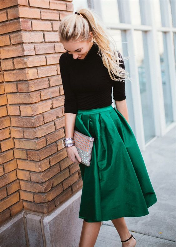 a party girl in a green skirt and a black sweater