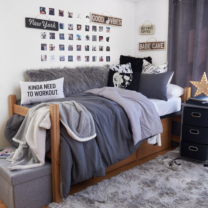 a student dorm room decorated in monochrome colors