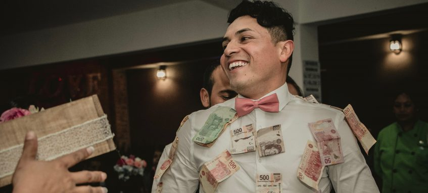 a student in shirt covered with banknotes