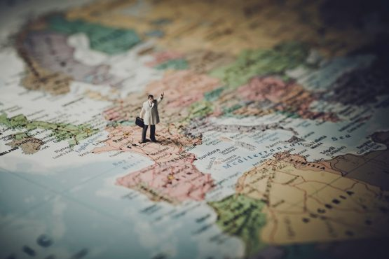 a miniature figure of a man standing on the map