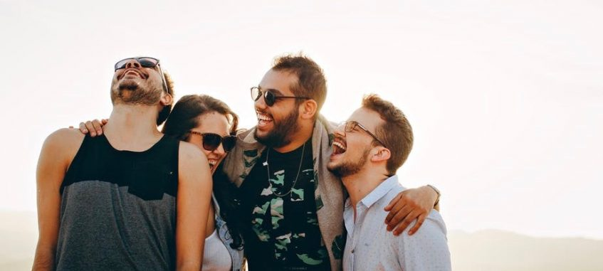 college students laugh at sunset