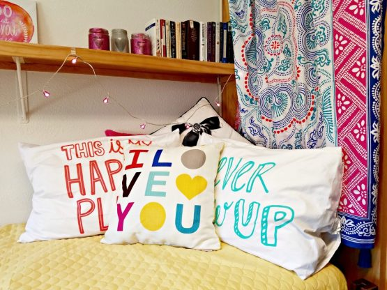colorful pillows placed on dorm bed