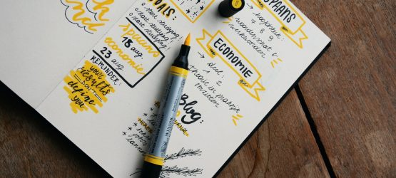 black and yellow doodles in the notebook