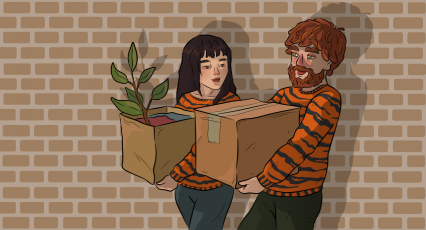 a guy and a girl in tiger sweatres are bringing boxes