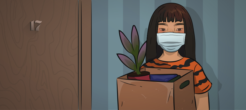 a girl in a tiger shirt and mask in standing with a box full of her belongings