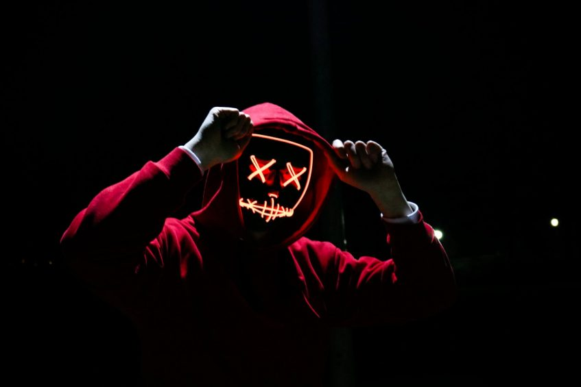 a guy in a glowing mask