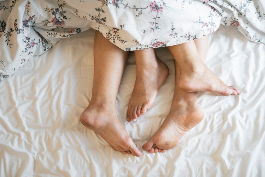 his and hers feets under the duvet
