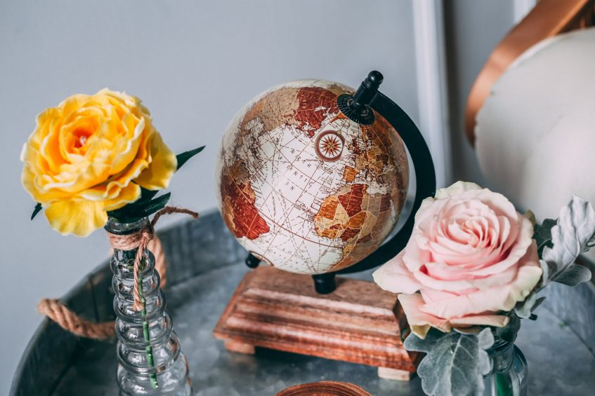 a globe and roses on the table
