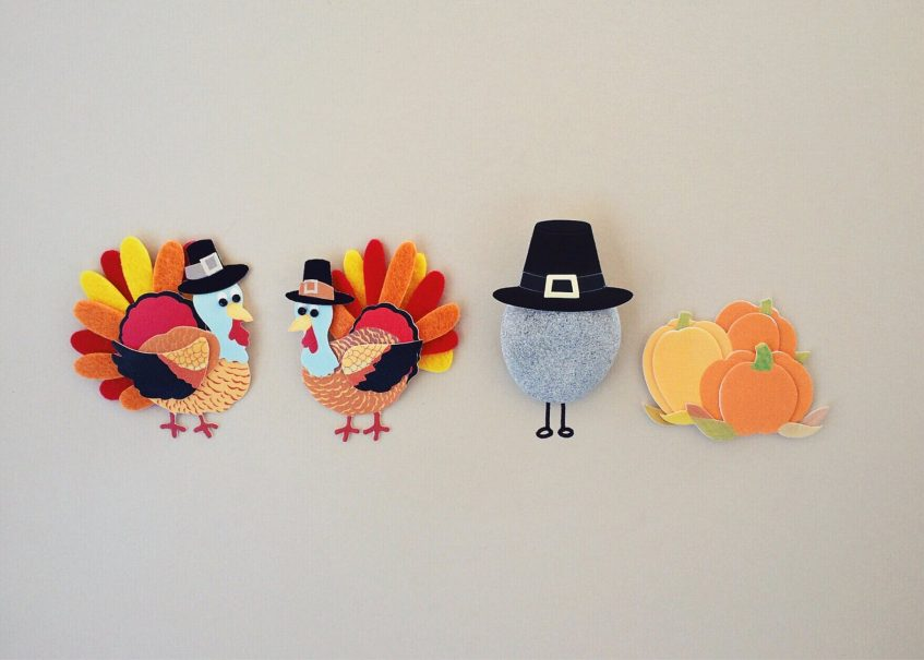 handmade turkeys, pumpkins and a stone in a hat