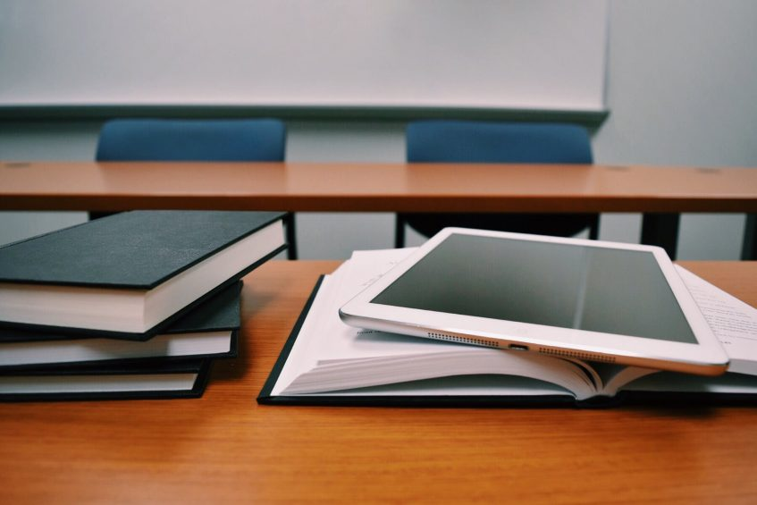 books and a tablet