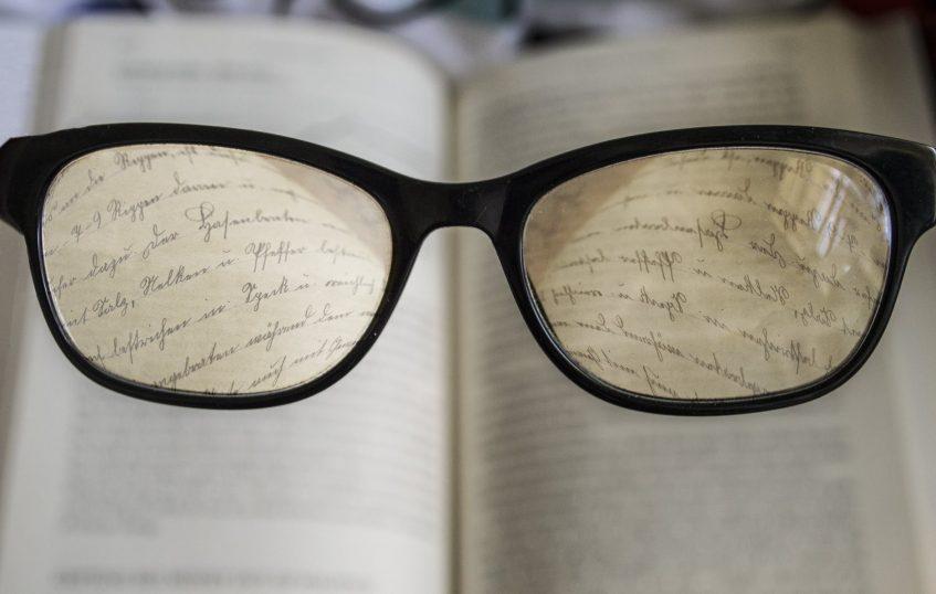 written words seen through the glasses