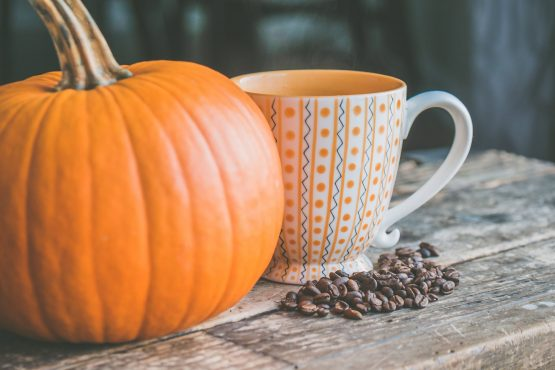a pumpking and a cup