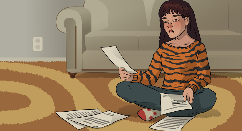 a girl in a tiger sweater is looking through the papers